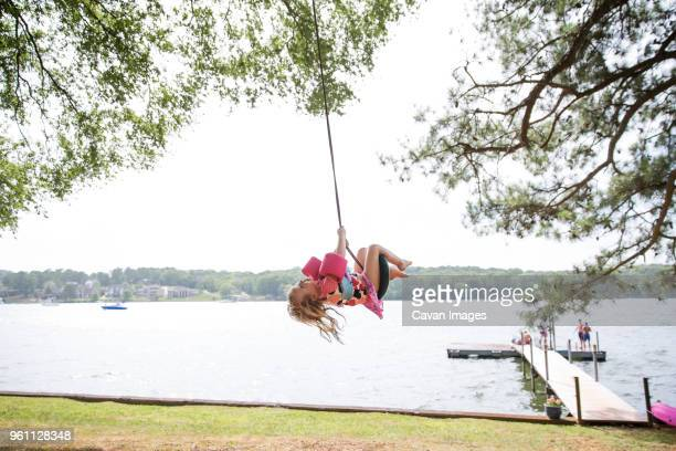 girl enjoying on tire swing at lakeshore - chattanooga stock pictures, royalty-free photos & images