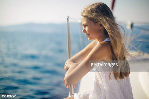 girl enjoying on yacht while sailing - yachting stock pictures, royalty-free photos & images