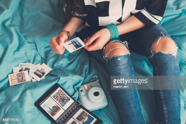 girl enjoying photos from the vacation - memories stock pictures, royalty-free photos & images