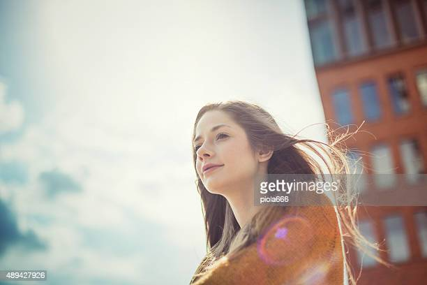 girl enjoying sunlight with dreamy look - girls sunbathing stock pictures, royalty-free photos & images