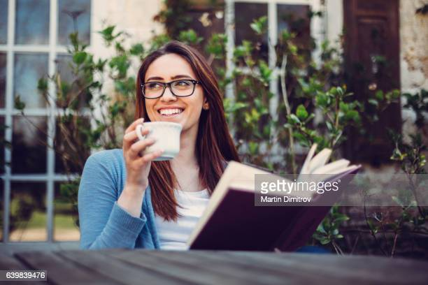 girl enjoying the weekend outside - reading glasses stock pictures, royalty-free photos & images