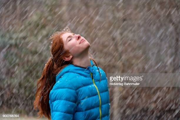 girl enjoying thick snowflakes in winter, upper bavaria, bavaria, germany - thick girls stock photos and pictures