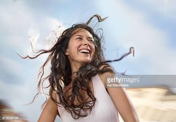 girl enjoying wind in her hair while moving - windswept stock pictures, royalty-free photos & images