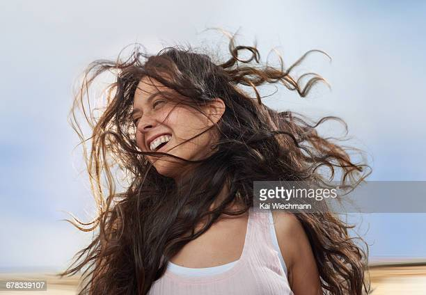 girl enjoying wind in her hair while moving - wavy hair stock pictures, royalty-free photos & images
