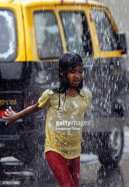 A girl enjoys monsoon rain at Wadala on June 7 2015 in Mumbai India According to Weather bureau from June 8 onwards continuous rain and...