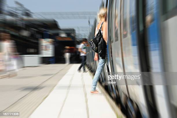 Girl entering train, daytime motion blurred picture