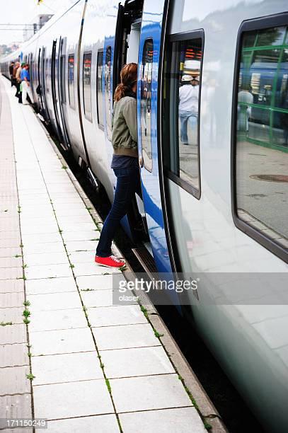 Girl entering train, mid day light