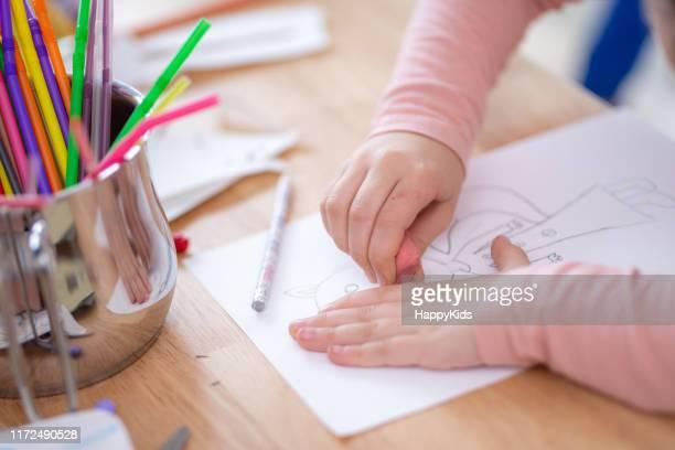 girl erasing drawing - eraser stock pictures, royalty-free photos & images