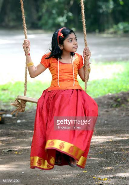 A girl erects special swings on the occasion of Onam festival on September 3 2017 in Kerala India Onam is an annual harvest festival of Kerala The...