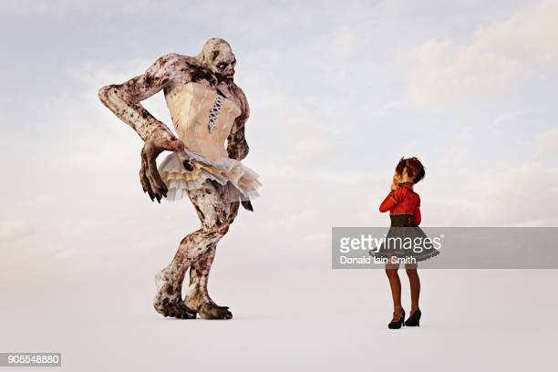 girl examining alien wearing dress - monster fictional character stock pictures, royalty-free photos & images