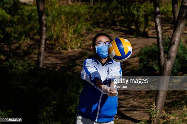 A girl exercises while wearing a mask as part of precautionary measures against the spread of the COVID19 on April 02 2020 in Beijing China Health...