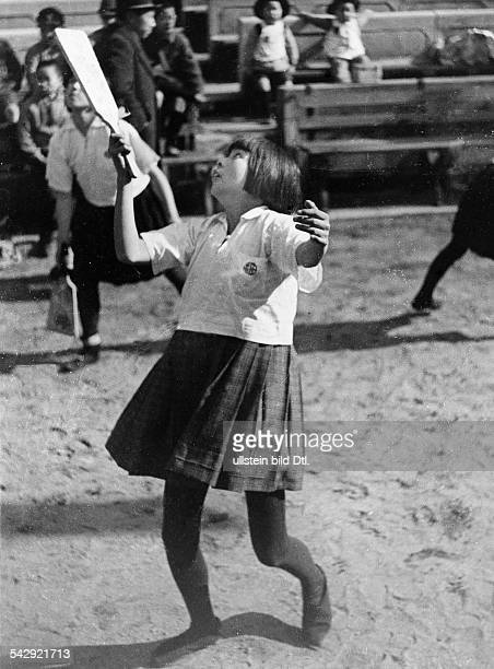 Girl exercising Hanetsuki a traditional form of badminton in a Japanese school Published in Koralle 31 / 1943 Photographer Werner Cohnitz