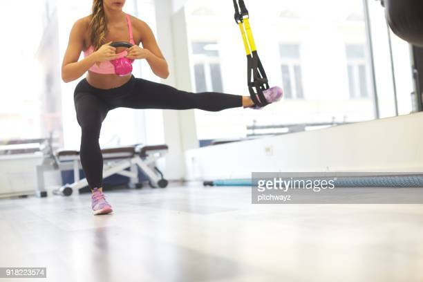 girl exercising in the gym - human limb stock pictures, royalty-free photos & images