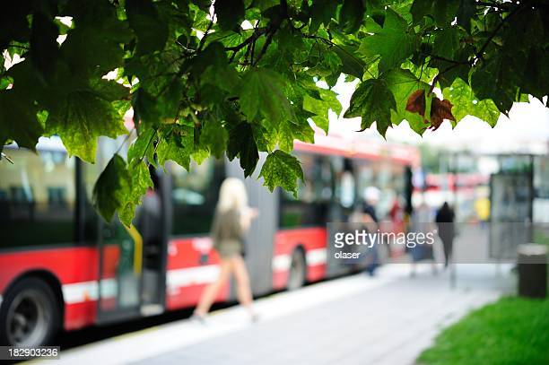 Girl exiting red bus