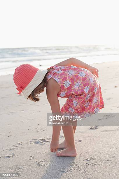 Girl exploring on the beach at sunset