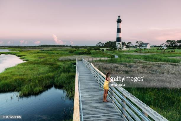 girl exploring the outer banks - marsh stock pictures, royalty-free photos & images