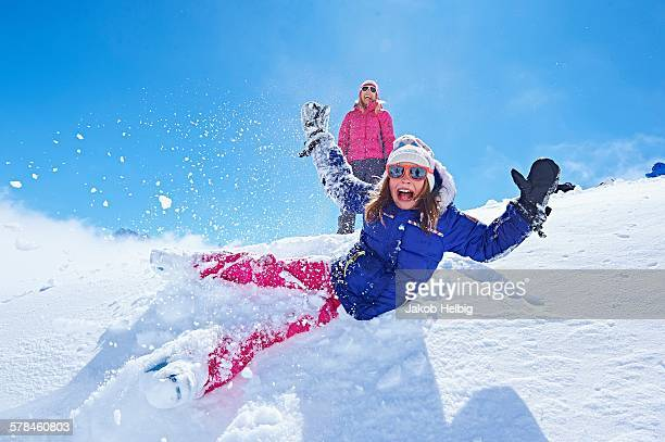 Girl falling into snow, Chamonix, France