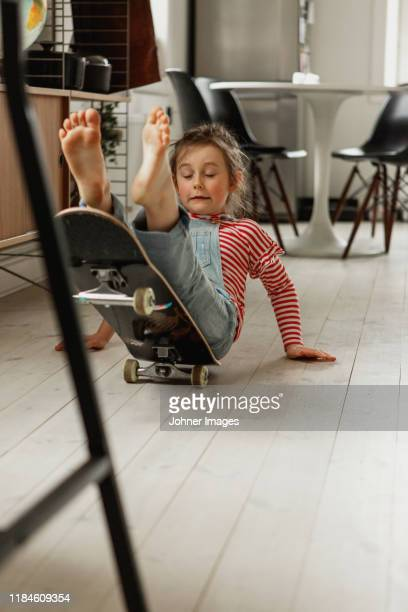 girl falling off skateboard - misfortune stock pictures, royalty-free photos & images