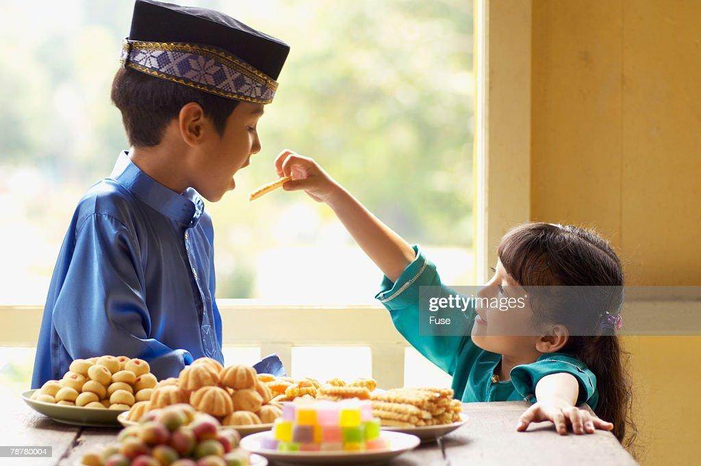 Top Child Eid Al-Fitr Food - girl-feeding-boy-sweets-for-malaysian-new-year-picture-id78780004?s\u003d612x612  Gallery_435084 .com/photos/girl-feeding-boy-sweets-for-malaysian-new-year-picture-id78780004?s\u003d612x612