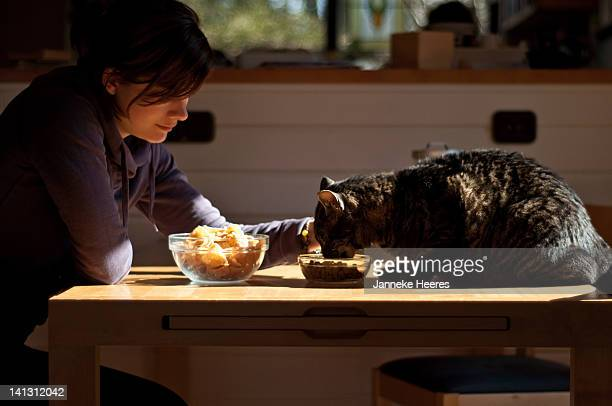 Girl feeding cat