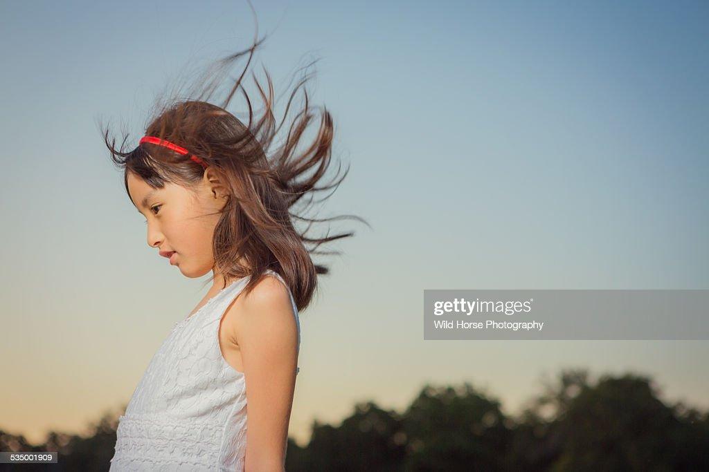 Girl feeling wind : Stock Photo