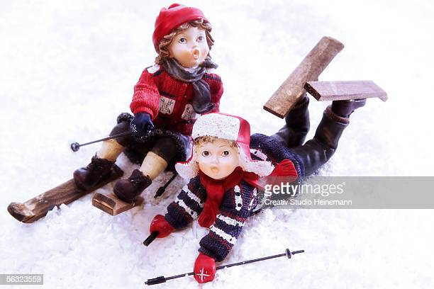 Girl figurines skiing