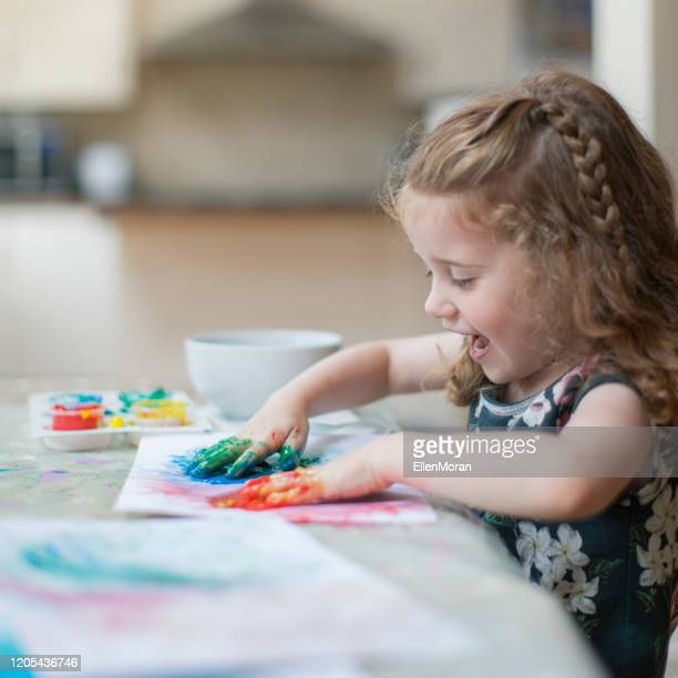 girl finger painting - craft stock pictures, royalty-free photos & images