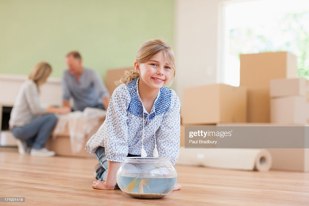 Girl fish bowl in her new house : Stock Photo