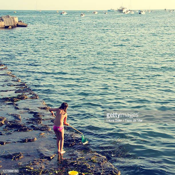 girl fishing on beach - wet girl stock photos and pictures