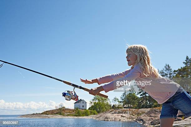 Girl fishing, Sweden.