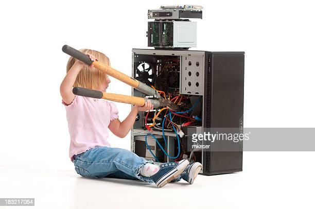 Girl 'fixing' a computer with hedge clippers.