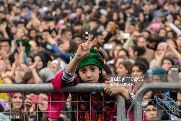 TOPSHOT A girl flashes a victory sign on March 8 2018 during a demonstration to mark International Women's Day in Diyarbakir southwestern Turkey /...