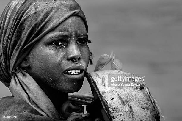 A girl fleeing from the genocide in Darfur