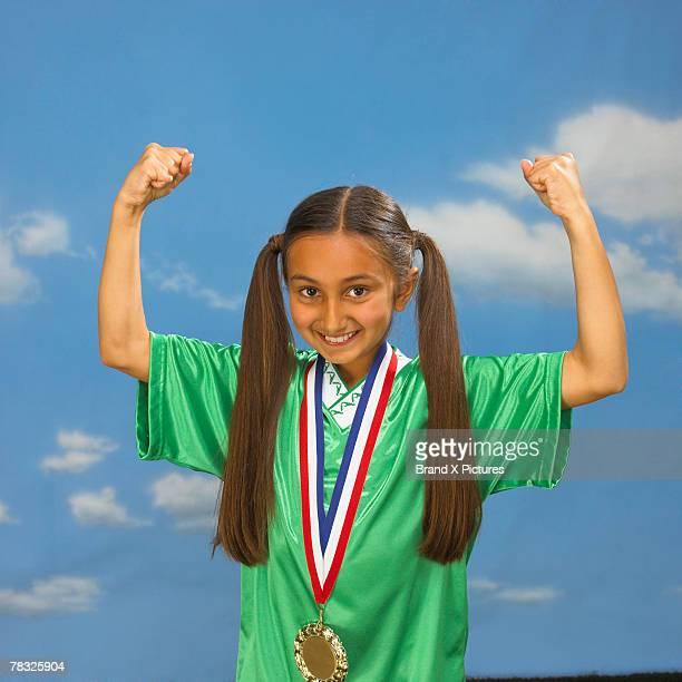 Girl flexing muscles