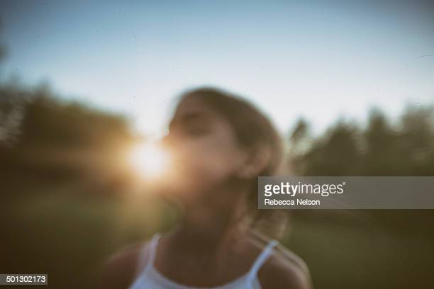girl flipping her hair around at sunset - rebecca nelson stock pictures, royalty-free photos & images