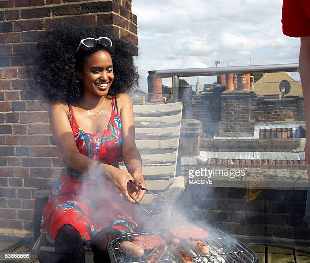 Girl flips burgers on the barbecue