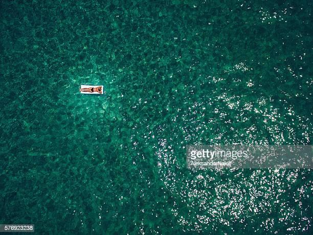 Girl floating in the ocean