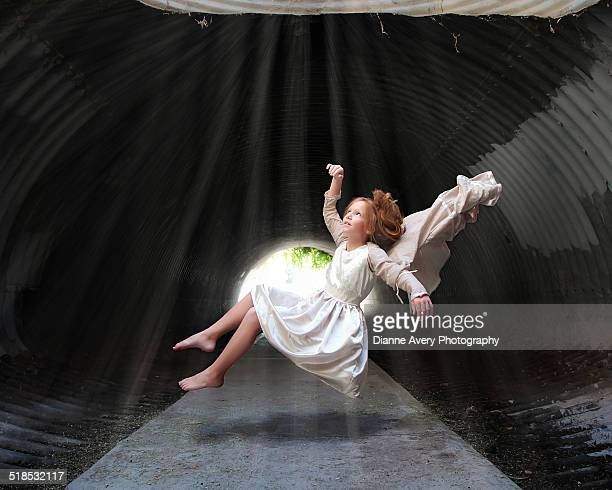 Girl floating in tunnel