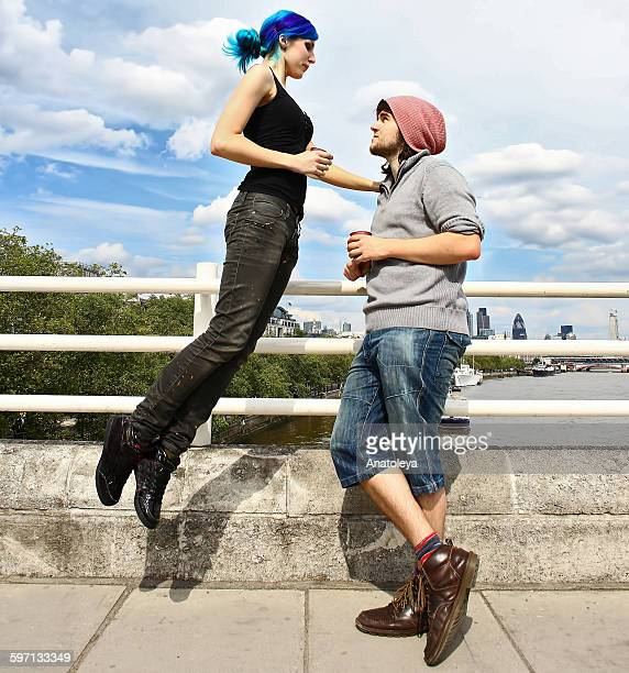 girl floating on bridge with boyfriend - anatoleya stock pictures, royalty-free photos & images
