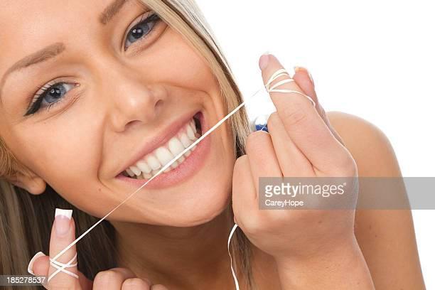 girl flossing teeth