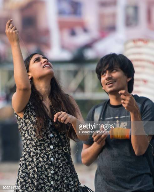 A girl flying kites on the occasion of 'Makar Sankranti' at Carter Road on January 14 2018 in Mumbai India Makara Sankranti is a festival day in the...