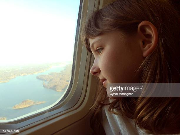 Girl Flying on an Airplane