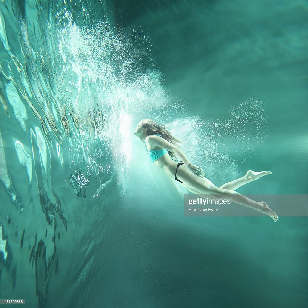 Girl flying underwater : Stock Photo