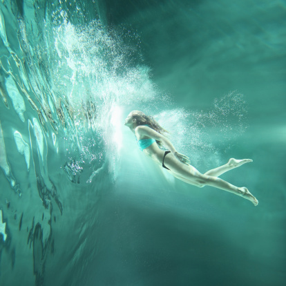 Girl flying underwater - gettyimageskorea