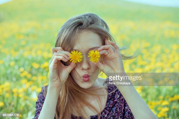 girl fooling around with dandelion flowers - hippie woman stock photos and pictures