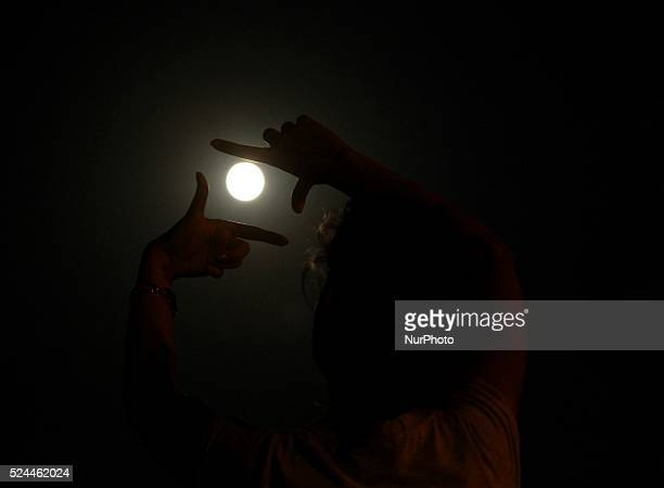 A girl frames by hands the full moon as it rising on Monday evening over the sky near the town of Omurtag Sep 2014 This Full Moon happens to be a...