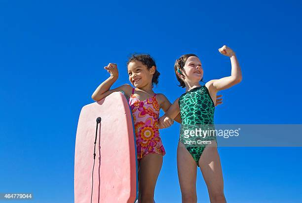 Girl friends hamming it up at the beach Paines Beach