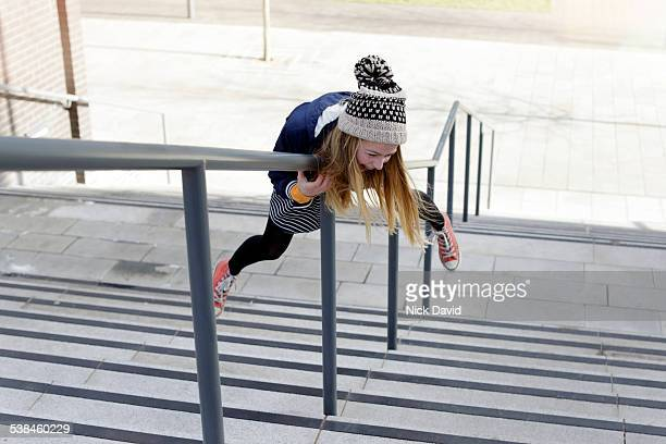 girl friends - railings stock pictures, royalty-free photos & images