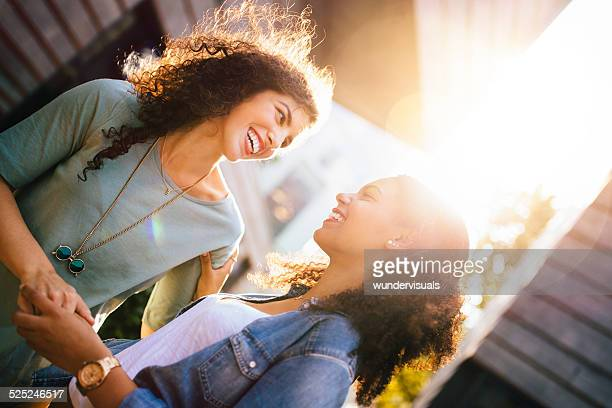 Girl Friends Reunite And Laugh Together In city