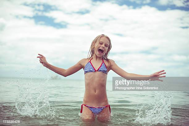 girl frisking in the sea - swimwear stock photos and pictures